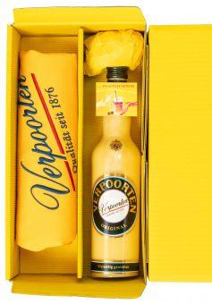 Geschenkverpackung mit 1 x 0,7 L Flasche VERPOORTEN ORIGINAL Eierlikör 20 %vol & exklusiv handbestickte VERPOORTEN-Schürze in schönem Verpoorten-Sonnengelb.